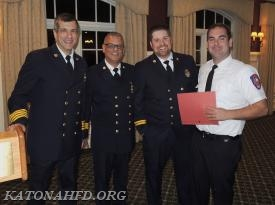 Bedford Hills FF Mark Kane is presnted with his mutual aid responder certificate. Photo by Gabe Palacio.