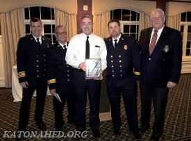 Tom Connolly, recipient of the Katonah Fire District's Michael J. Vuotto Award. At right is Chairman of the Board of Fire Commissioners Henry Bergson. Photo by Gabe Palacio.