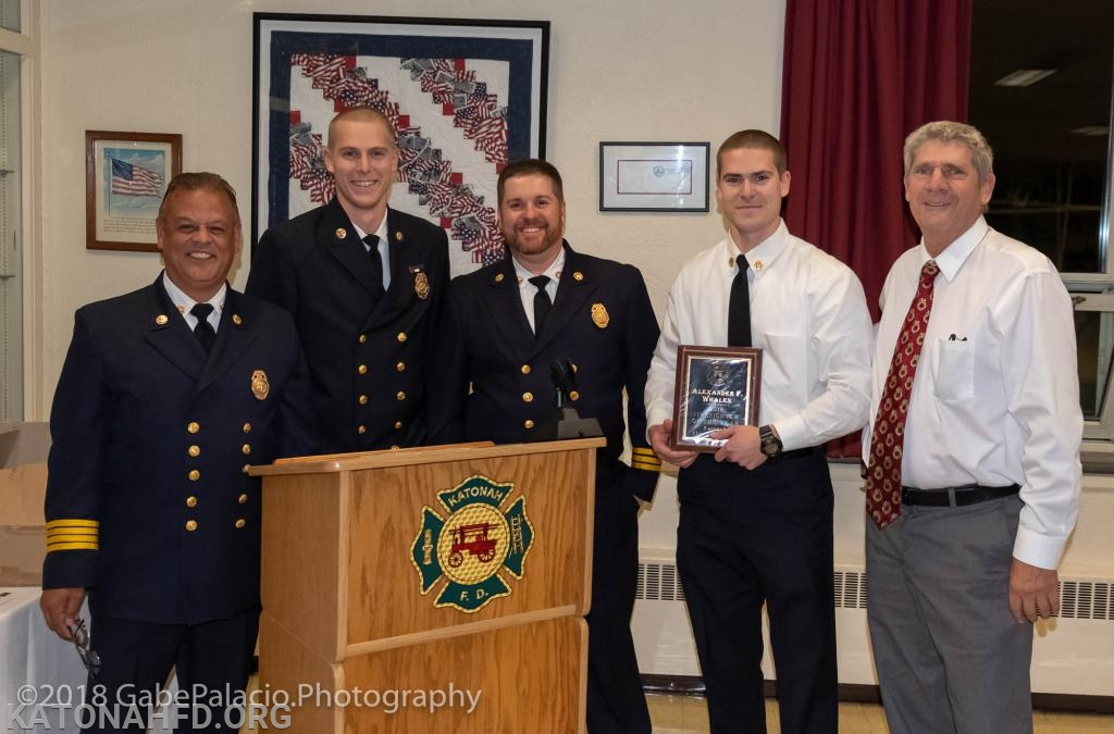 2018's Firefighter of the Year Award went to Captain Alex Whalen. He's seen here with the Chiefs and, at right, with his father, Ex-Chief and Commissioner Bruce Whalen.