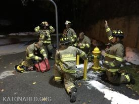 """Getting equipment from the hydrant kit to """"dress"""" the hydrant."""