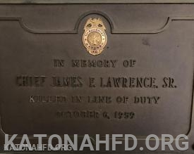 Chief Lawrence's Chief's badge and memorial plaque at KFD Headquarters.
