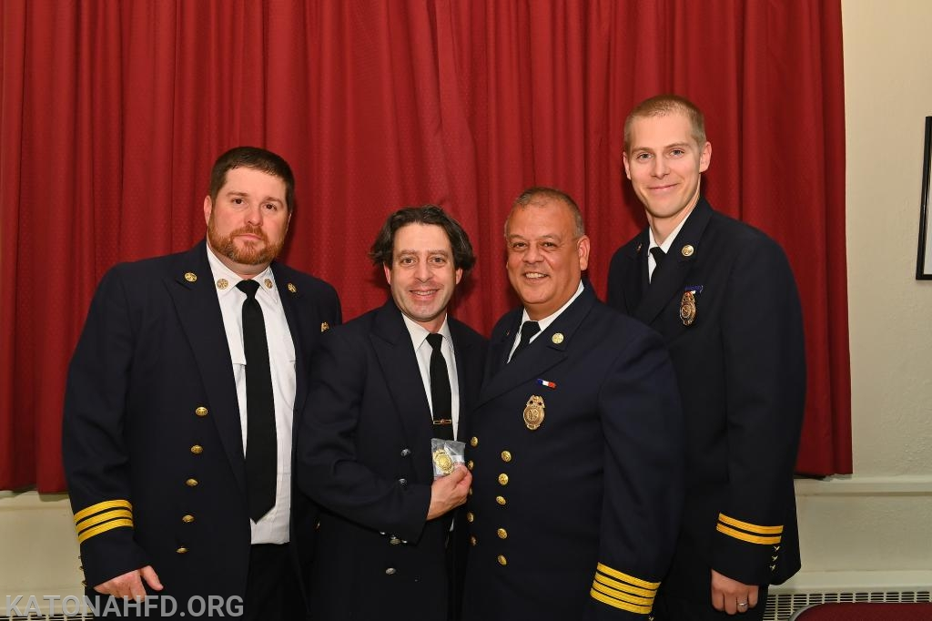 Firefighter Davide Palmerini is given his 25 Year Badge. Photo by Gabe Palacio