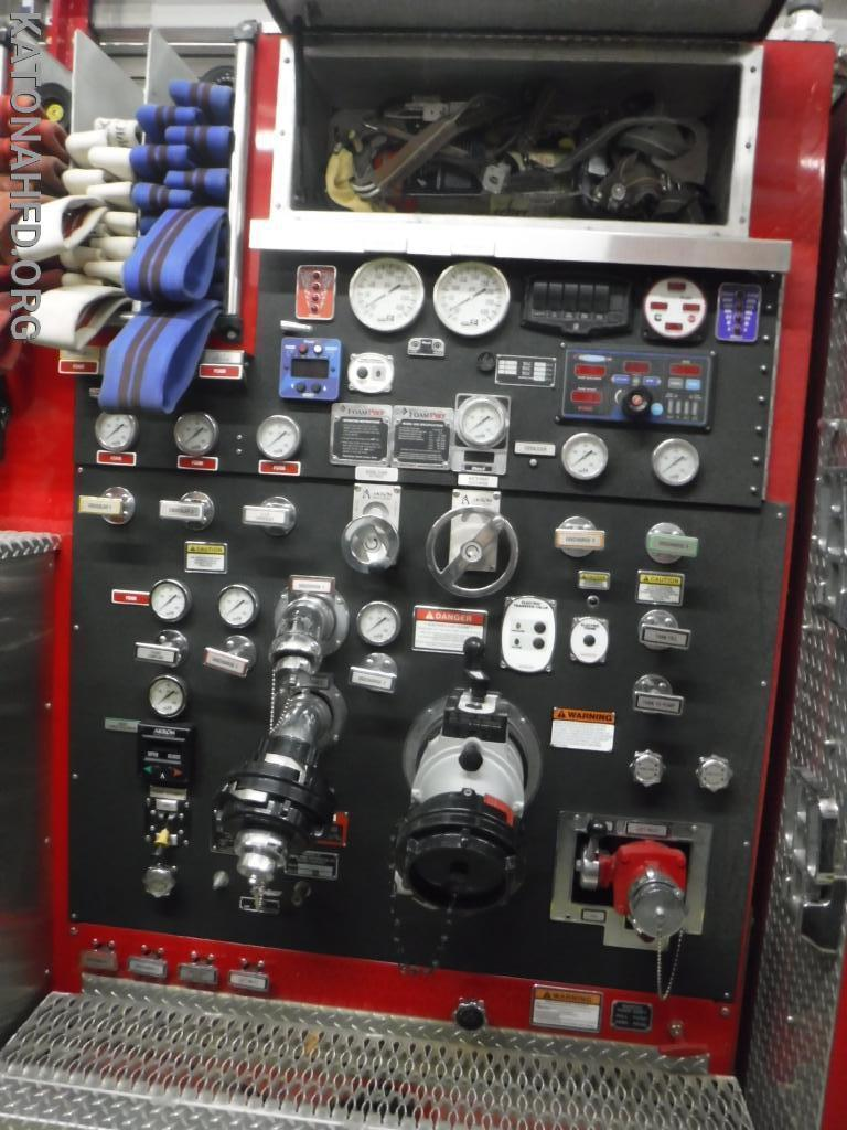The pump panel, with various intakes and discharges, and their controls.