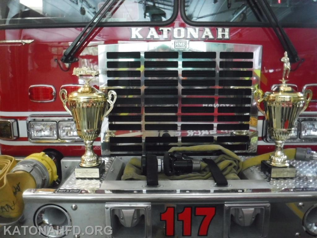 The two trophies on the bumper of Engine 117.