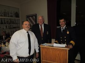 Ex-Chief Paul Bauer, recipient of the Michael J. Vuotto Award, with Board of Fire Commissioners Chairman Henry Bergson and Chief Dean Pappas. Photo by Gabe Palacio